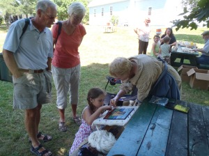 Demonstrating rug hooking at Orwell Corner