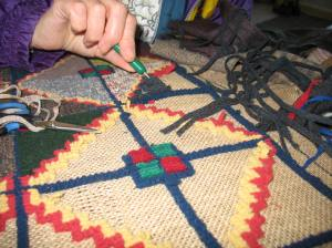 Hooking a new Cavendish rug at Pastimes PEI